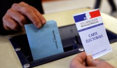 A man casts his vote in the ballot box in a polling in Montpellier as France goes to the polls in the first round of regional elections March 14, 2010. The two-round election on March 14 and 21 will decide the governments for 26 regions in metropolitan France and the overseas territories with authority over issues such as local transport and maintaining school buildings. REUTERS/Jean-Paul Pelissier  (FRANCE - Tags: POLITICS ELECTIONS)